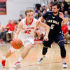 Don Knight |  The Herald Bulletin<br /> Frankton's Travis McGuire drives as he is guarded by Oak Hill's Cal Mann on Friday.