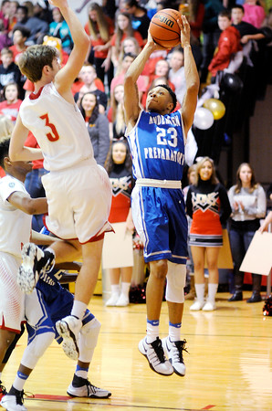 Don Knight   The Herald Bulletin<br /> APA's Da'ion White shoots as he is guarded by Liberty Christian's Isaiah Brees at The Den on Friday.