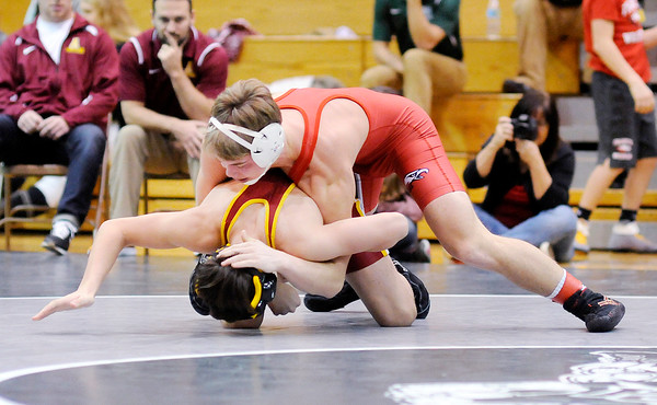 Don Knight | The Herald Bulletin<br /> Frankton's Grant Geisinger wrestles Alexandria's Nick Sarvis in the 145 pound championship during the Madison County wrestling tournament at Pendleton Heights on Saturday.