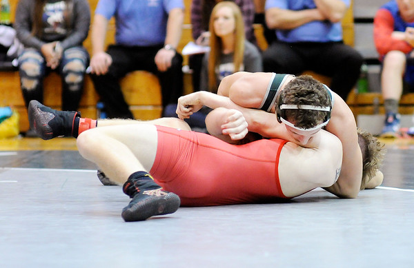Don Knight | The Herald Bulletin<br /> Pendleton Heights Alex Johnson pins Frankton's Cody Klettheimer after reversing out of a hold in the 152 pound championship during the Madison County wrestling tournament at Pendleton Heights on Saturday. Johnson won the Fred Lamb Outstanding Wrestler award.