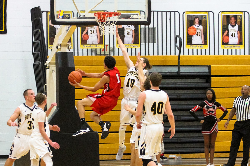 . Barry Booher - The News-Herald Elijah Martin goes up against Jamison Campbell.