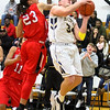 Barry Booher - The News-Herald<br /> Harvey's Bishop Thomas attempts to block Riverside's Brandon Horn's shot.