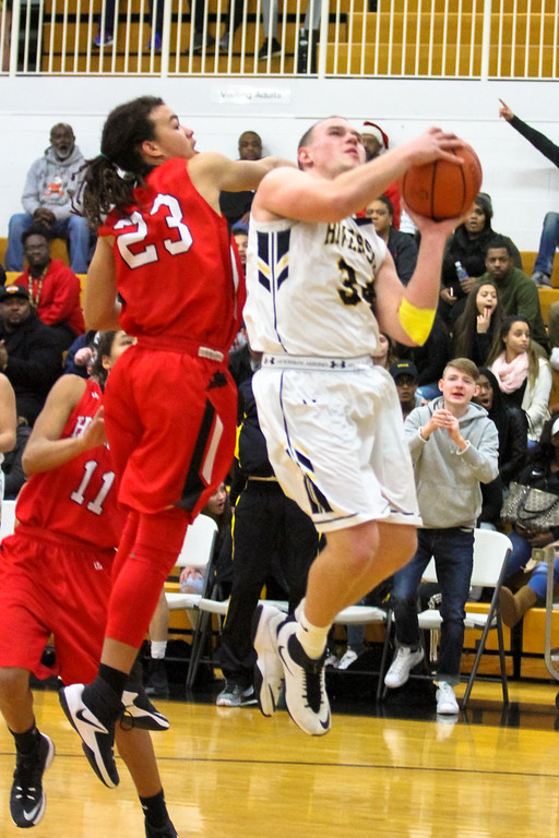 . Barry Booher - The News-Herald Harvey\'s Bishop Thomas attempts to block Riverside\'s Brandon Horn\'s shot.