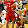 Barry Booher - The News-Herald<br /> Andrew Keller drives and is fouled by Harvey's Marc Berry. Keller made both foul shots with 3.7 seconds left to give Riverside the lead 58-57. Harvey failed to get off a shot at the end.