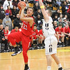 Barry Booher - The News-Herald<br /> Harvey's Bishop Thomas drives to the basket on Riverside's Brandon Horn.