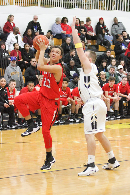 . Barry Booher - The News-Herald Harvey\'s Bishop Thomas drives to the basket on Riverside\'s Brandon Horn.