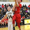 Barry Booher - The News-Herald<br /> Harvey's Devon Holbert lays up a shot on Brandon Horn.