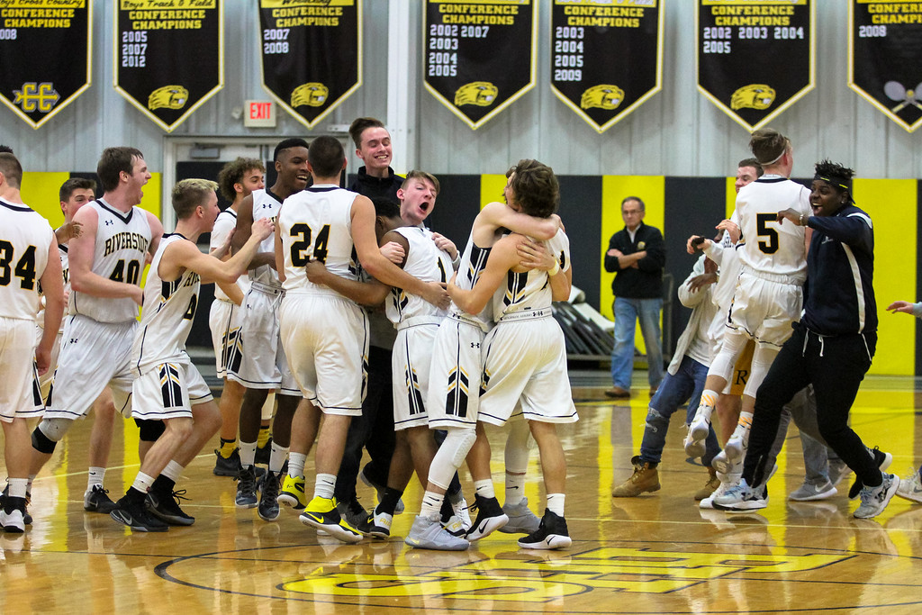 . Barry Booher - The News-Herald Riverside celebrates its 58-57 victory over Harvey.