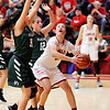 Don Knight |  The Herald Bulletin<br /> Frankton's Destyne Knight looks to shoot after grabbing a rebound as she is guarded by Aubree Dwiggins and Lauren Landes in the first round of the Madison County Tournament at Frankton on Tuesday.