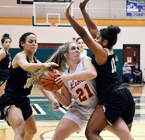 John P. Cleary | The Herald Bulletin<br /> Lapel's Makynlee Taylor and Morgan Knepp put the pressure on Liberty Christian's Paige Grant as she tries to pass the ball.