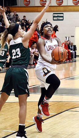 John P. Cleary | The Herald Bulletin<br /> Anderson's Staisha Hamilton gets a step on Pendleton's Kylie Davis as she drives the lane for a shot.