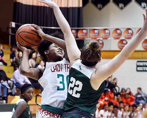 John P. Cleary | The Herald Bulletin<br /> Anderson's Tyra Ford goes up for a shot as Pendleton's Kailyn Graham tries to defend.