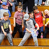 Don Knight |  The Herald Bulletin<br /> Young Alexandria fans dance as music plays during the team's warmup before they hosted Shenandoah on Thursday.
