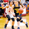 Don Knight |  The Herald Bulletin<br /> Shenandoah's Kathryn Perry drives as she is guarded by Alexandria's Reece VanBlair on Thursday.