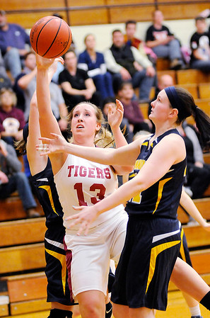 Don Knight |  The Herald Bulletin<br /> Alexandria's Mackenzie McCarty drives for a layup against Shenandoah's Hannah Cole as the Tigers hosted the Shenandoah raiders on Thursday.