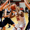 Don Knight   The Herald Bulletin<br /> Anderson's Tyquez Priester draws a trio of defenders as he shoots from the low post as the Indians hosted the Shenandoah Raiders on Friday.
