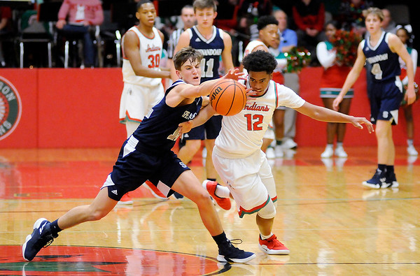 Don Knight | The Herald Bulletin<br /> Anderson's Marcus Armstrong is called for a foul as he tries to steal the ball from Shenandoah's Andrew Bennett on Friday.