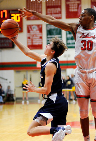 Don Knight | The Herald Bulletin<br /> Shenandoah's Jakeb Kinsey shoots as he is guarded by Anderson's Tyquez Priester as the Indians hosted the Raiders on Friday.