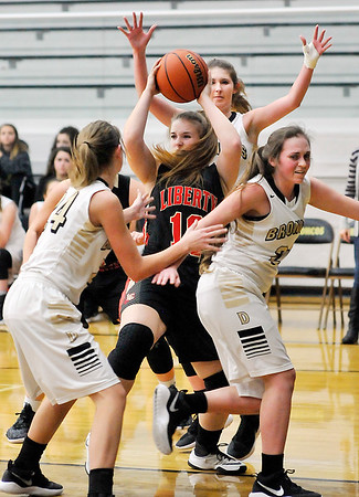 John P. Cleary | The Herald Bulletin<br /> Liberty Christian's Paige Grant is surrounded by Daleville's defense.