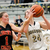John P. Cleary | The Herald Bulletin<br /> Daleville's Heather Pautler gets fouled by Liberty Christian's Maddy Harmon as Pautler goes up for a shot.