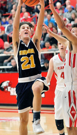 John P. Cleary |  The Herald Bulletin<br /> Shenandoah's Andrew Bennett goes strong to the basket beating the Frankton defenders.