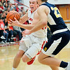 John P. Cleary |  The Herald Bulletin<br /> Frankton's Travis McGuire tries to get a step on Shenandoah's Braydin Myers as he drives the lane.