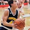 John P. Cleary |  The Herald Bulletin<br /> Shenandoah's Chase Kinsey eyes the basket has he drives the lane against Frankton's Sebastian Davis.