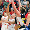John P. Cleary |  The Herald Bulletin<br /> Frankton's Kayden Key gets a shot off as he falls down after being fouled by Shenandoah's Dylan Frost.