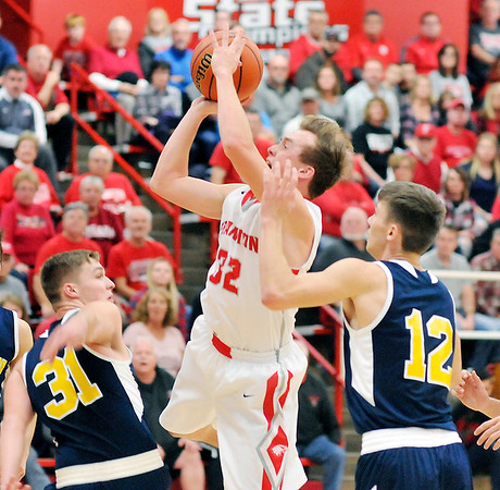 John P. Cleary |  The Herald Bulletin<br /> Frankton's Travis McGuire goes up for a shot against Shenandoah's Gavin Patrick and Jordan Starks.