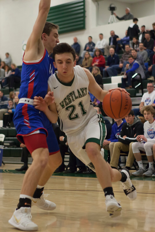 . Jen Forbus - The Morning Journal<br> Westlake guard Tommy Lazevnick tries to drive through Bay guard Daniel Brajdic on Dec. 22.
