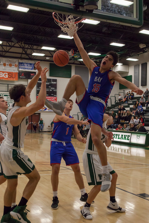 . Jen Forbus - The Morning Journal<br> Bay\'s RJ Sunahara throws down a monster dunk against Westlake on Dec. 22.