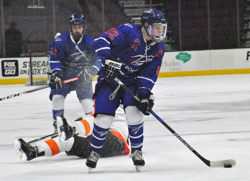 . Jon Behm - The Morning Journal<br> Bay\'s Jake Gaudino looks for an opening to shoot during the first period against North Olmsted on Dec. 22 at The Q. Gaudino had four goals in the Rockets\' loss.