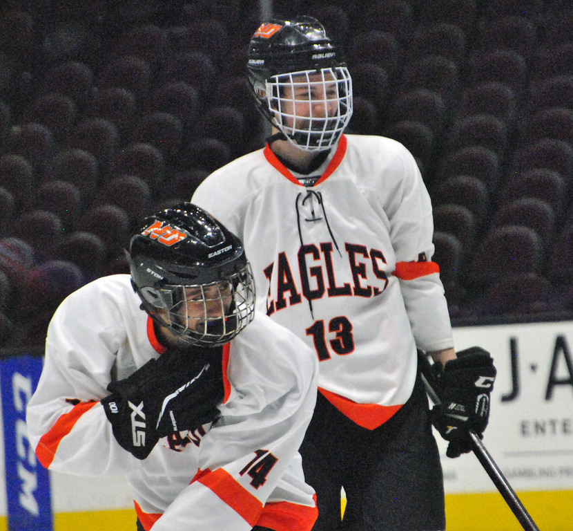 . Jon Behm - The Morning Journal<br> North Olmsted\'s Ryan Godin celebrates his first goal with teammate Shawn Donovan during the second period against Bay on Dec. 22 at The Q. Godin, the normal starting goalie for the Eagles, took the ice for North Olmsted and scored a pair of goals.