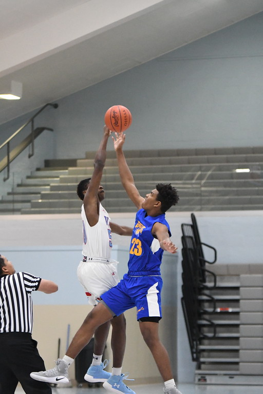 . Patrick Hopkins - The News-Herald Photos from the VASJ vs. New Day boys basketball game on Dec. 23.