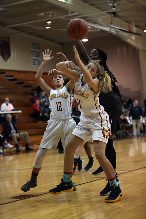 . Randy Meyers - The Morning Journal<br> Avon Lake\'s Taylor Baiers and Arianna Negron battle Nemaja\' Grant of Lorain for a  rebound during the first quarter on Dec. 23.