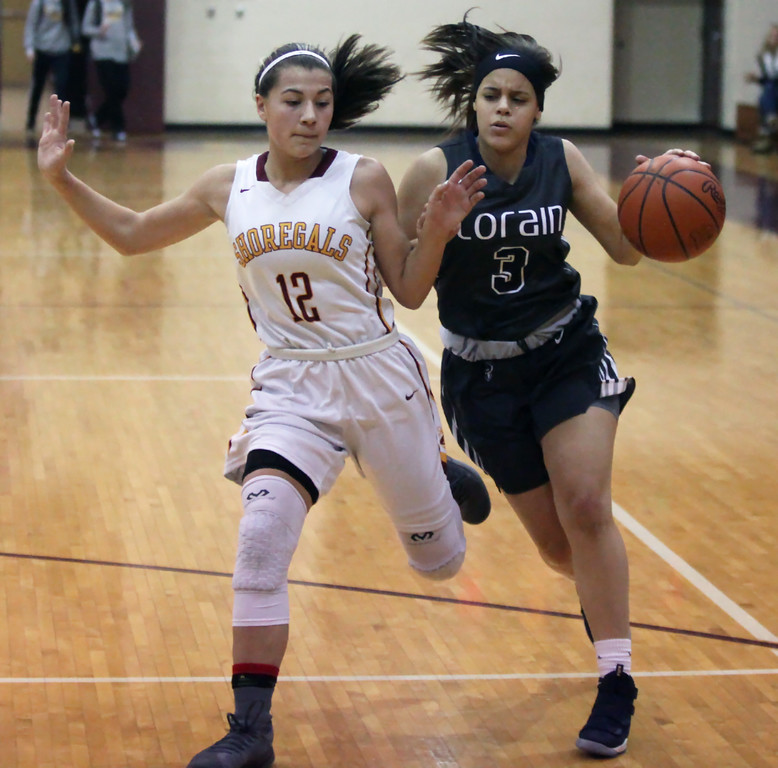 . Randy Meyers - The Morning Journal<br> Normajanae Bohannon of Lorain is pressured by Arianna Negron of Avon Lake as she brings the ball upcourt during the first quarter on Dec. 23.