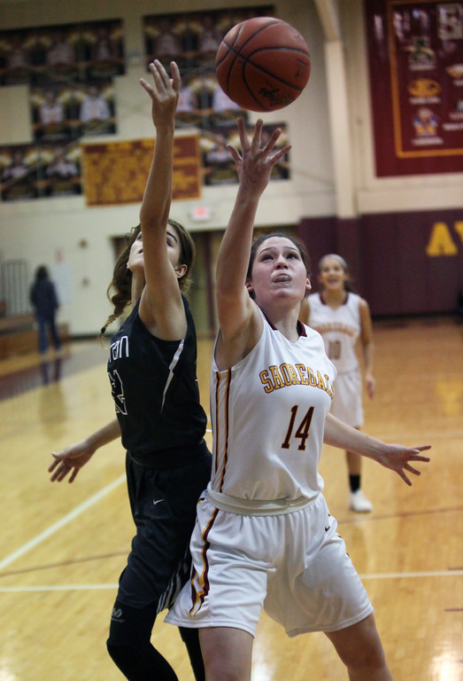. Randy Meyers - The Morning Journal<br> Bridget Molnar of Avon Lake and Nicole Ortiz of Lorain reach for a rebound during the second quarter on Dec. 23.