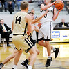 Don Knight | The Herald Bulletin<br /> Daleville's Connor Fleming drives into the lane for a basket as the Broncos hosted the Lapel Bulldogs on Saturday.