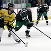 Randy Meyers - The Morning Journal<br /> Tyler Waldecki of Amherst moves the  puck past Hunter Jeppe of Mayfield during the second period in a holiday hockey tournament Dec. 26 in Parma.
