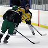 Randy Meyers - The Morning Journal<br /> Tyler Waldecki of Amherst slaps the puck past Hunter Jeppe of Mayfield during holiday hockey tournament Dec. 26 in Parma.