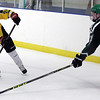 Randy Meyers - The Morning Journal<br /> Jacob Fekete of Amherst slaps the  puck past Mayfield's Cole Sherman to a teamate during the first period of a holiday hockey tournament Dec. 26 in Parma.