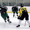 Randy Meyers - The Morning Journal<br /> Mayfield's Ethan Macula moves the  puck toward Tyler Waldecki of Amherst at center ice during a holiday hockey tournament Dec. 26 in Parma.