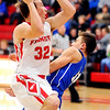 John P. Cleary |  The Herald Bulletin<br /> Frankton's Travis McGuire drives into the lane against Eastern Hancock's Brycen Napier and makes contact and draws the foul.