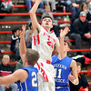 John P. Cleary |  The Herald Bulletin<br /> Frankton's Keegan Freestone splits the defenders to put up a shot along the baseline.