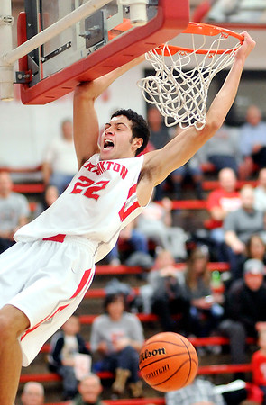 John P. Cleary |  The Herald Bulletin<br /> Frankton's Maurice Knight makes a monster dunk on a break-away against Eastern Hancock.