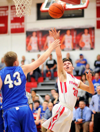 John P. Cleary |  The Herald Bulletin<br /> Frankton's Kayden Key, right, lets go with a shot as Eastern Handcock's Peyton Gray tries to defend.
