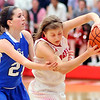 John P. Cleary |  The Herald Bulletin<br /> Eastern Hancock's Leah Ferguson reaches in and fouls Frankton's Sydney Tucker.