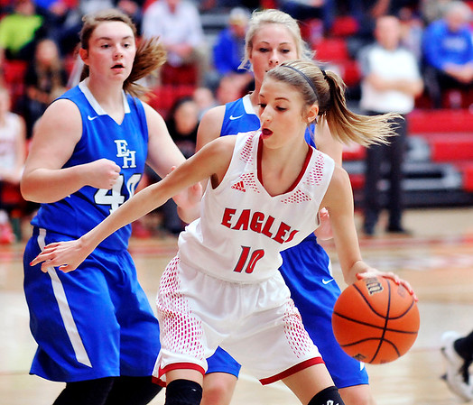 John P. Cleary    The Herald Bulletin<br /> Frankton's Addie Gardner drives into the lane against Eastern Hancock defenders.