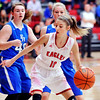 John P. Cleary |  The Herald Bulletin<br /> Frankton's Addie Gardner drives into the lane against Eastern Hancock defenders.