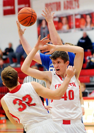 John P. Cleary |  The Herald Bulletin<br /> Frankton's Travis McGuire and Rylan Detling fight for a loose rebound.